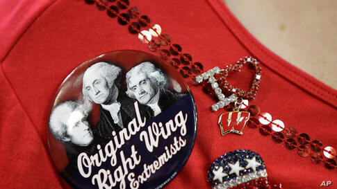 Dona Poelman from Racine, Wisconsin accessorizes her shirt at the RNC.