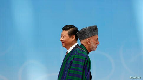 Afghan President Hamid Karzai (R) walks away after shaking hands with his Chinese counterpart Xi Jinping before the opening ceremony in the Expo Center during the fourth Conference on Interaction and Confidence Building Measures in Asia (CICA) summit i...