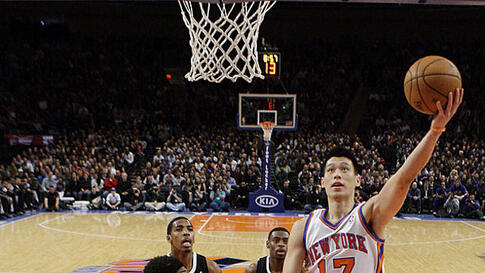 New York Knicks' Jeremy Lin drives past Sacramento Kings' DeMarcus Cousins during an NBA basketball game on February 15, 2012, in New York. Lin had 10 points and 13 assists as the Knicks won the game 100-85. (AP)
