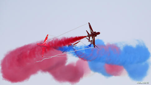 The Red Arrows, the British Royal Air Force Aerobatic Team, performs at the Malta International Airshow 2013 at Malta International Airport, outside Valletta, Malta, Sept. 29, 2013.