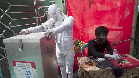 """Indonesian election officials are dressed as horror characters to attract voters in Surabaya city in eastern Java island and deliver a message to the elected leader to clean the """"evils"""" in government."""