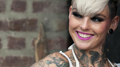 A tattoo enthusiast poses at the London Tattoo Convention in London, Sept. 29, 2013.