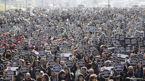 Protesters march to Agos newspaper office during a demonstration to mark the seventh anniversary of the killing of Turkish-Armenian journalist Hrant Dink in Istanbul, Turkey.