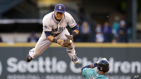 San Diego Padres second baseman Alexi Amarista leaps to get out of the way of sliding Seattle Mariners' James Jones (99) at second base in the fourth inning in a baseball game in Seattle, Washington, USA, June 16, 2014.