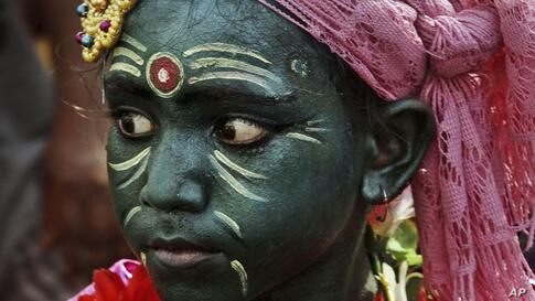 An Indian boy with his face painted participates in a procession on the occasion of Chandan Yatra festival in Puri, 65 kilometers (40 miles) from the eastern Indian city of Bhubaneswar. Chandan Yatra means Sandalwood Voyage, where devotees smear the de...
