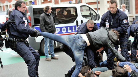 """Policemen drag away a protester during a demonstration of artists and entertainment workers, known as """"intermittents du spectacle"""", near the Regional Directorate of Cultural Affairs (DRAC) in Lille, northern France, to protest against the government's ..."""