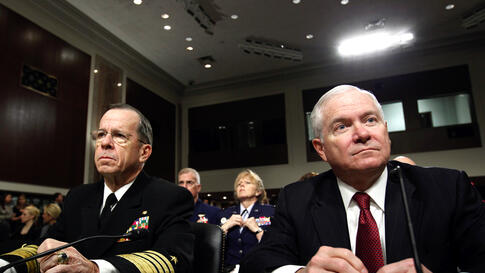 """U.S. Secretary of Defense Robert Gates (R) and Chairman of the Joint Chiefs of Staff Admiral Mike Mullen testify before the Senate Arms Services Committee hearing about the """"Don't Ask, Don't Tell"""" policy on gays serving in the military in Washington Decem"""