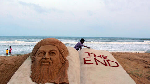 May 2: Sand artist Sudarshan Pattnaik gives finishing touches to a sculpture to mark the killing of Osama bin Laden at the golden sea beach at Puri, Orissa, India. (AP Photo/Biswaranjan Rout)