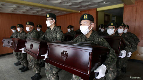 South Korean army soldiers hold caskets containing the remains of Chinese soldiers to be transported to Incheon International Airport, at the temporary columbarium in Paju. The remains of 437 Chinese soldiers killed during the 1950-53 Korean War were t...