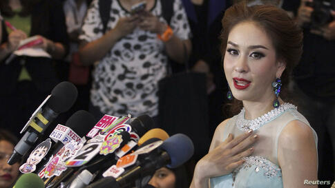 """Miss Universe Thailand Weluree Ditsayabut speaks during a news conference at Renaissance Hotel in Bangkok. Ditsayabut renounced her title over remarks she made on social media including one that """"red shirt"""" activists, supporters of ousted prime ministe..."""