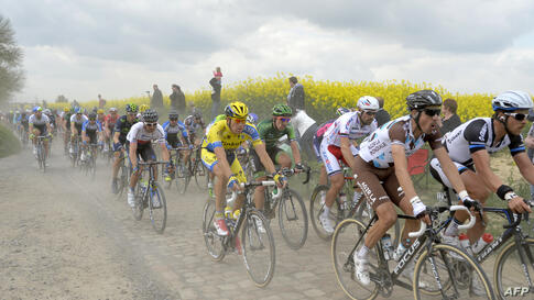 The pack rides through a cobblestoned section during the 112th edition of the Paris-Roubaix one-day classic cycling race between Compiegne and Roubaix, northern France.