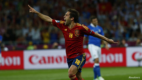 Spain's Jordi Alba celebrates after scoring a goal against Italy during their Euro 2012 final soccer match at the Olympic stadium in Kiev July 1, 2012