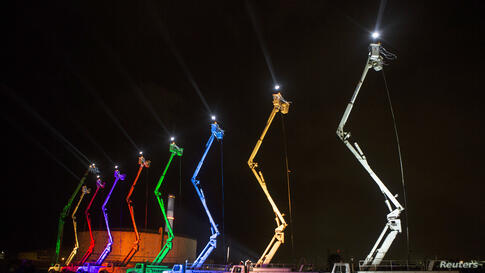 The lights are turned on for a giant menorah at the Reading Power Station in Tel Aviv, on the Jewish holiday of Hanukkah, Dec. 4, 2013.