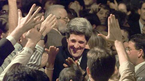 Senator John Kerry is swarmed by supporters as he arrives for a re-election victory rally in Boston, Massachusetts, November 5, 1996.