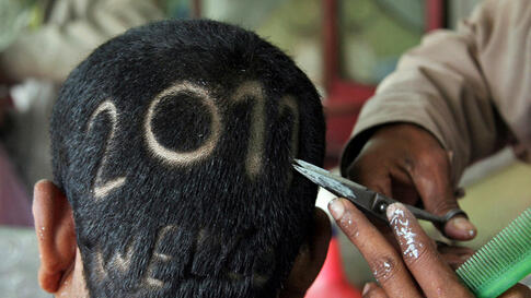 Dec. 27: A man gets a haircut depicting 2011 to welcome the new year at a barbershop in the northern Indian city of Allahabad. 2010. (Jitendra Prakash/Reuters)