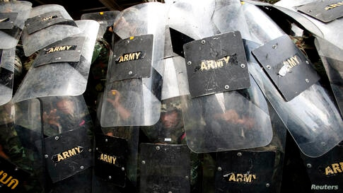 Soldiers take up positions to block protesters against military rule at a shopping district in central Bangkok, Thailand. Military tightened its grip on power as it moved to douse smouldering protests fuelled by social media and to rally commercial age...