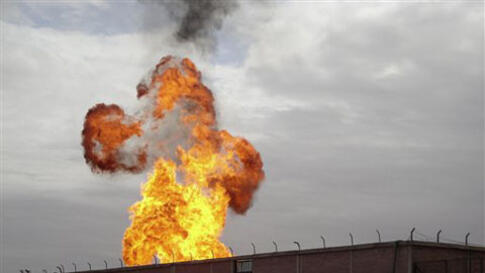 Flames are seen after an explosion went off at a gas terminal in Egypt's northern Sinai Peninsula, February 5, 2011, in El-Arish, setting off a massive fire