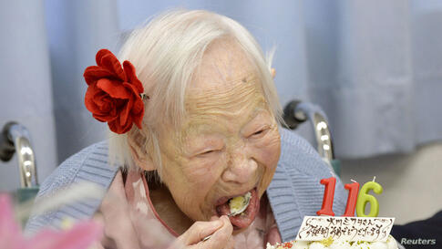 Japanese Misao Okawa, the world's oldest woman, eats her birthday cake as she celebrates her 116th birthday in Osaka, western Japan, in this photo taken by Kyodo.