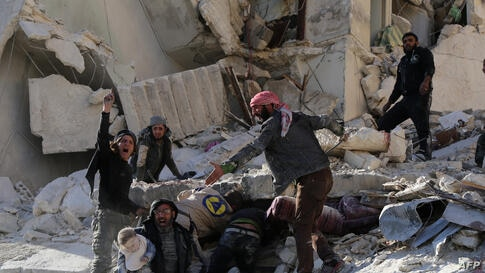 Civilians and rescue workers remove a toddler and search for other victims amid the rubble of a building following a reported air strike by Syrian government forces on the Sukkari neighborhood of Syria's northern city of Aleppo.