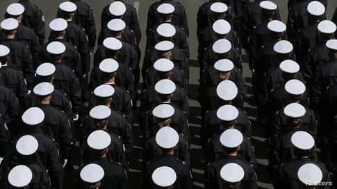 New French police officers stand at attention during a ceremony at the Police Prefecture in Paris, France.