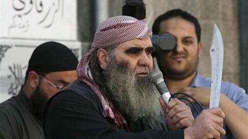 A Salafi protester holds a sword during a demonstration for extremist Salafi Muslims in the town of Zarqa, east of Amman, Jordan, Friday, April 15, 2011. The Islamic hard-liners clashed with supporters of Jordan's king, wounding dozens, in the latest move