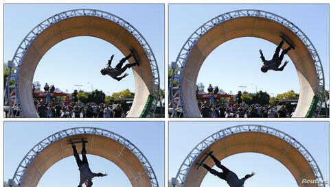 A combination of four pictures shows skateboarder Aaron 'Jaws' Homoki of Phoenix, Arizona managing to stay on his board as he completes his attempt to ride a 15-foot (4.6-metre) high skateboard loop in Vista, California, Oct. 20, 2013.