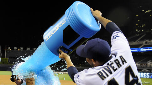 San Diego Padres center fielder Will Venable (left) is soaked with Powerade by catcher Rene Rivera (44) after Venable drove in the winning runs during the twelfth inning against the Kansas City Royals at Petco Park in San Diegom, California, May 5, 321...