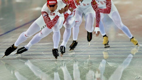 Speedskaters from Russia train at the Adler Arena Skating Center prior to the opening of the 2014 Winter Olympics in Sochi, Russia.
