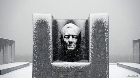 Snow falls on the statue of Franklin D. Roosevelt at Four Freedoms Park on Roosevelt Island in the borough of Manhattan in New York, Feb. 3, 2014.