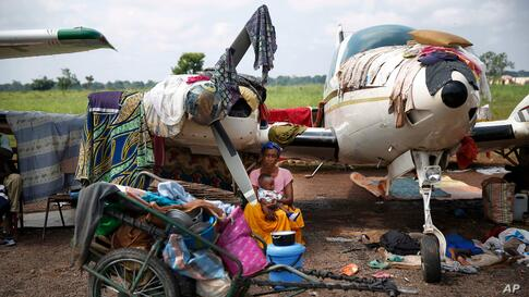 Christians gather in a makeshift camp for internally displaced people set in the airport in Bangui, Central African Republic. Over 30,000 have gathered there after days of sectarian violence, prompting the U.N. to start food distribution a kilometer away.