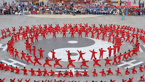 "People perform ""tai chi"" during the launch ceremony of the 12th Handan International Tai Chi Conference in Handan, north China's Hebei province. Over 1,700 from around the world gathered to attend the conference."