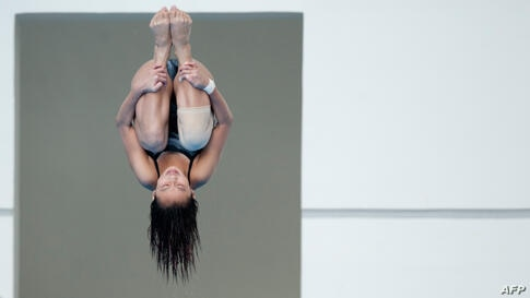 Singapore's Fong Kay Yian competes during the women's three-meter springboard diving event at the 27th SEA Games in Naypyidaw, Burma.