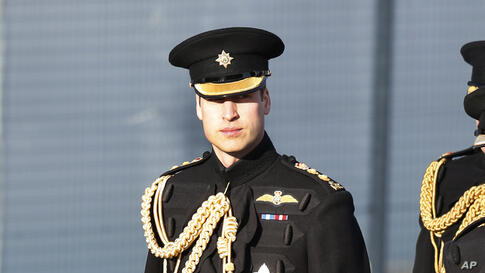 Britain's Prince William arrives at an army base in Aldershot, England, for a ceremony of presentation of operational service medals for service in Afghanistan to No2 Company of the 1st Battalion Irish Guards.