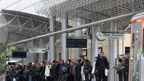 Commuters wait for the first train after a five-hour work stoppage by urban rail workers, as all other public transport employees are on a 48-hour strike, in Athens on February 10, 2012. (AP)