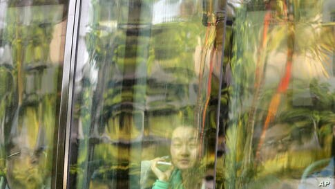 Chinese relatives of passengers on board the missing Malaysia Airlines flight MH370 look from inside a bus as they arrive at a hotel in Subang Jaya, Malaysia.