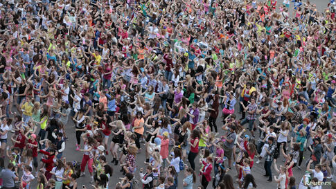 People perform a Gangnam style dance during a flash mob before the arrival of South Korean rapper Psy at the Olympiyskiy (Olympic) sports and entertainment complex in Moscow, Russia.
