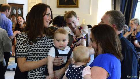 Britain's Catherine, Duchess of Cambridge, holds her son Prince George as she talks to other parents at a Plunket play group event at Government House in Wellington, New Zealand.