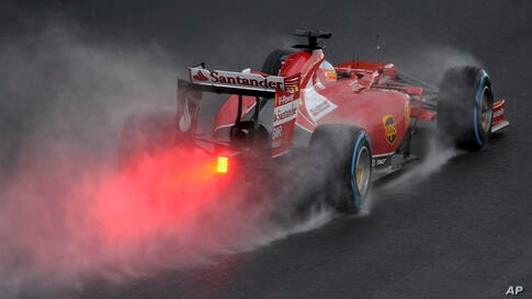 Ferrari driver Fernando Alonso of Spain controls his car on turn two during the qualifying session at Albert Park ahead of the Australian Formula One Grand Prix in Melbourne.