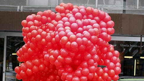 A young man sells red balloons shaped into hearts on Valentine's  Day in Ankara, Turkey, February. 14, 2012. (AP)