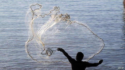 A fisherman casting a net over the waters of Lake Cocibolca, the biggest lake in Nicaragua. (Reuters)
