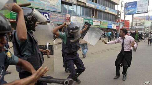 Bangladeshi police baton charge an activist to stop him from marching towards the Pakistani Embassy in Dhaka.