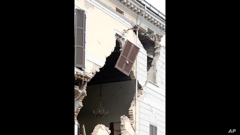 The damaged town hall building in St' Agostino, Italy, May 20, 2012. A magnitude-5.9 earthquake shook northern Italy between Modena and Mantova, about 35 kilometers north-northwest of Bologna at a relatively shallow depth of 10 kilometers, the U.S. Geolog
