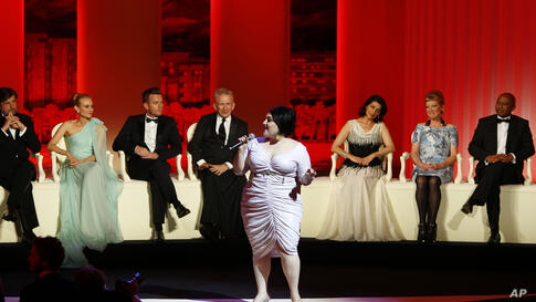 Singer Beth Ditto, at front, performs as members of the jury from left, Nanni Moretti, Diane Kruger, Ewan McGregor, Jean-Paul Gaultier, Hiam Abbass, Andrea Arnold, and Raoul Peck at the opening ceremony at the 65th international film festival, in Cannes,