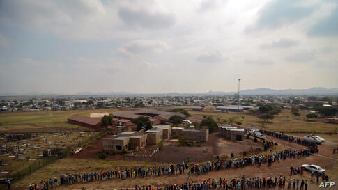Voters queue at the Rakgatla High School voting station in Marikana, South Africa, where residents reported waiting for more than four hours in the country's general elections.