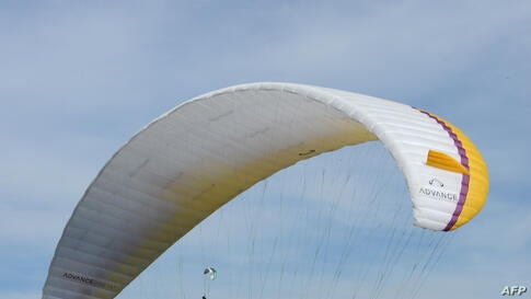 A paraglider competes in Saint-Hilaire-du-Touvet, southeastern France, during the 40th edition of the Icare Cup, Sept. 22, 2013.