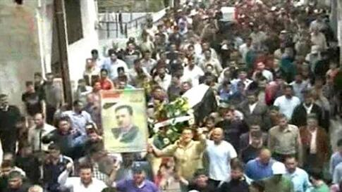 Syrian Arab News Agency (SANA) handout photo shows people gathering for funeral of two people allegedly killed in recent clashes in Homs, 160 kilometers (100 miles) to the north of Damascus on April 19, 2011.