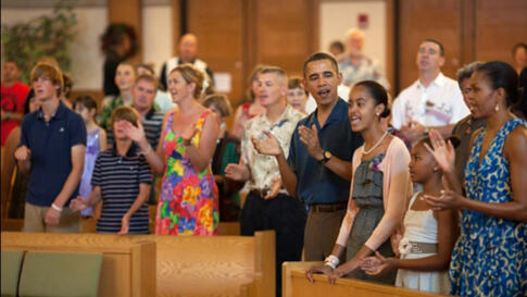 Obama and Michelle Obama, daughters, sing during services at St. Michael's Chapel at Marine Corps Base Hawaii
