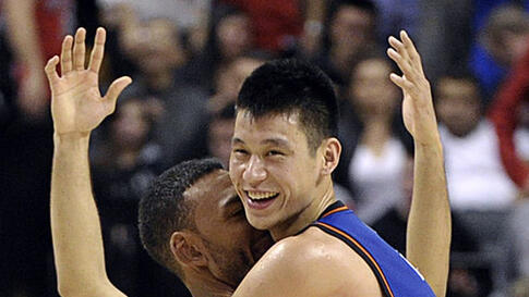 New York Knicks guard Jeremy Lin (R) and Jared Jeffries celebrate their win against the Toronto Raptors during the second half of their NBA basketball game in Toronto February 14, 2012. (REUTERS)