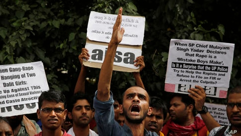 Members of Jawaharlal Nehru University Students Union shout slogans during a protest against a gang rape of two teenage girls in Katra village, outside the Uttar Pradesh state house, in New Delhi, India.