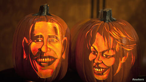 Pumpkins carved in the likeness of U.S. President Barack Obama and First Lady Michelle Obama are lit at Madame Tussauds in New York.